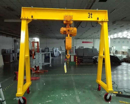 Adjustable gantry crane with electric hoist for sale